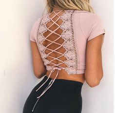 - Cropped top with v cleavage and lace up detail on the back - Color: Black, Pink, White - Material: Spandex, Nylon - Size: S, M, L - Check the picture for size measurements