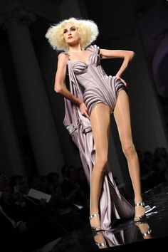 A model walks the runway during Jean-Paul Gaultier Fashion Show as part of Paris Fashion Week Haute Couture A/W 2009/10  on July 8, 2009 in Paris, France.