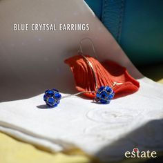 """Estate West Grand - Blue Crystal Earrings. Dazzling blue crystals adorn these silver chain drop earrings. Perfect for a night out! 3"""" long. $25."""