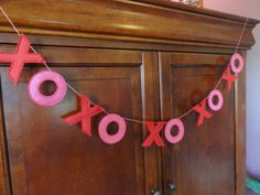 Hugs and Kisses Garland is just perfect for Valentines Day! Display this Felt and Satin Valentine Garland from the fireplace, over furniture,