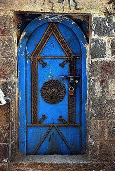locked up old blue door