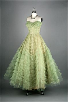 1950s pale green tulle and lace ballgown.  I like the ruffled tulle flounces, but they would likely read as too young.  Perhaps incorporated into an underskirt or petticoat.