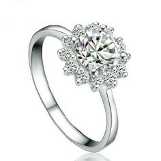 Stylish & elegant, this gemstone 925 sterling silver flower ring is made with clear crystal Zircons. Add personality to your image with this gemstone ring in extravagant design that will add personality to your look for much less than you should pay for. Sterling Silver Flowers, Wedding Rings For Women, 1 Carat, Flower Designs, Round Diamonds, Bridal Jewelry, Gemstone Rings, White Gold, Jewels
