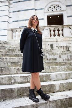 the austere black dress worn with ankle boots