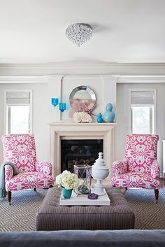 i like this layout for my living room.  chairs around the fireplace, a tufted ottoman and a couch facing...and PINK!