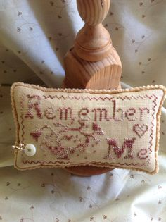 """Hand stitched cross stitched brown and cream"""" Remember Me"""" sampler style pin cushion  I can make this in other colors-- message me on Etsy for a custom order!!"""