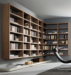:: FURNITURE :: STUDIOS :: Image Credit: Crossing Misura Emme. inspiration image for interesting shelving solutions. Love wall hung  off the floor library walls. #studios #wallshelving