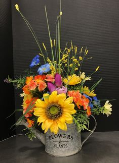 Multi Colored Bouquet in a Watering Can by Andrea