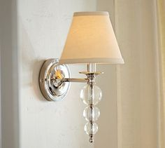 Stacked Crystal Sconce #potterybarn  for the living room. Ties in with the dining room fixture; is still traditional but slightly more modern with the lucite