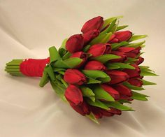 beautiful bouquet of red tulips with red ribbon on the stems