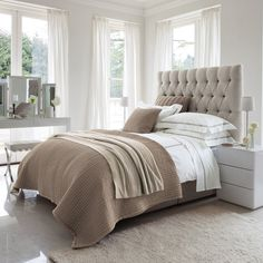 chic boutique hotel suite glamour for the bedroom  -  deep buttoned (tufted) headboard and stylish accessories - The White Complany