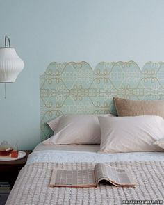 Using the lines in a graphic wallpaper as your guide, cut out a silhouette that serves as a virtual headboard.