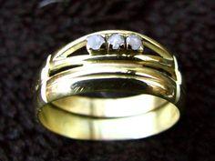 Twee trouwringen (erfstuk) tot één ring verwerkt.
