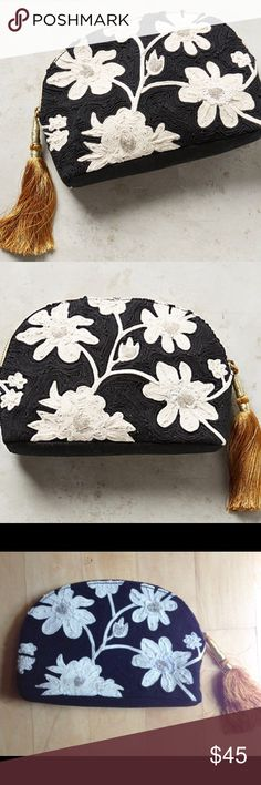"""Anthropologie Floris Pouch Beautiful black and white embroidered cotton pouch from jasper and jeera :) perfect for date night with LBD or even daytime parties with friends❤️                                                                      Cotton; cotton lining Tassel detail Zip closure Imported Dimensions 6""""H, 9.5""""W, 1.75""""D Anthropologie Bags Clutches & Wristlets"""