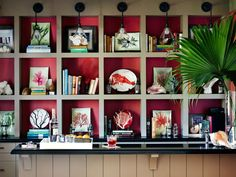A bold hot pink background makes custom built-in shelving really pop.