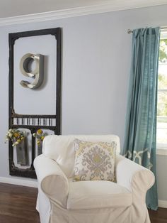 Great idea to re-purpose an old screen door.  This would also look great in an outdoor living space.