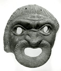 Theatre mask:  Terracotta comic mask of a slave.  Culture/period  Roman,  Date:  1stC BC-1stC  Production place: Italy