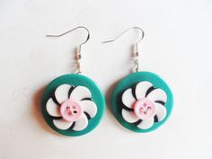 Quirky button earrings with silver hooks and turquoise, pink and a black and white flower buttons. Unusual and kitsch by SelmaDreams on Etsy