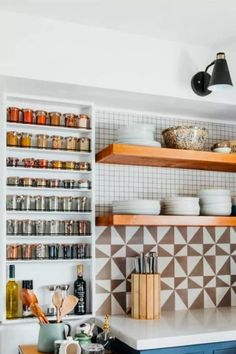 Gosh... I'm lovin this wall mounted spice rack with those simple little jars!