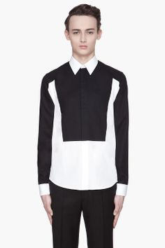 Givenchy White And Black Trompe Loeil Contrast Shirt - Givenchy White And Black Trompe Loeil Contrast Shirt Givenchy Long sleeve dress shirt in white cotton poplin. Spread collar. Button fly front. Contrasting_textured bib front. back yoke. and exterior sleeves in black. Shirttail hem. Tonal stitching. Single_button barrel cuffs. Price...
