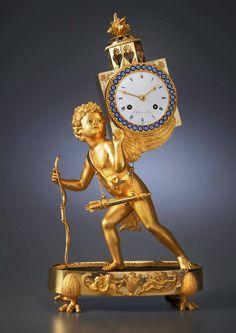An Empire mantel clock 'à la lanterne magique' , by L. Grognot 1800