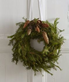 holiday wreath + pine cones