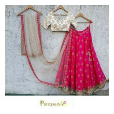 Define your summer wedding look in this fresh fuchsia lehenga paired with subtle white brocade blouse and nude dupatta for you best friend s wedding For more information write to info@pritisahni.com PritiSahni bride usabride bridaldress lehengas ClientDiaries