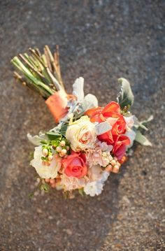 We love this simple Celosia Orange wedding bouquet!