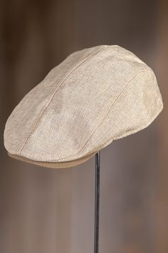 "edbc92fbc03 This fine linen Ivy Cap finishes any outfit with a signature that says  ""classic."