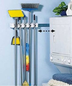 Store 'N' SlideTM Organizer. Smart Wall Mounted Broom Storage Rack. Slides to Hide Behind Furniture. Recommended for Use in Pantry, Laundry, Kitchen Garage to Organize Brooms, Dusters and Mops.