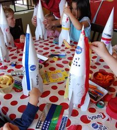 Water Rockets.  Either have all the kids (young & old) decorate the rockets together, and then shoot them off as a group.   OR, split up older and smaller kids and have the younger kids do a non-water rocket.