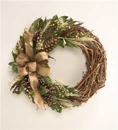 Idea for wreath: grapevine, pinecones, wheat or dried grass and magnolia leaves