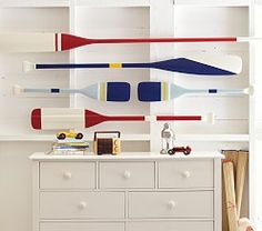 LOVE the painted oars as décor for a child's room - great nautical appeal and super design sense!