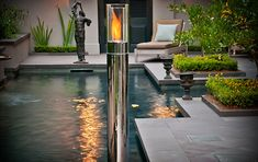 FIRE PILLAR  Add a touch of natural flair to your environment without messing up your carefully curated modern life with the Fire Pillar. Made from carbon steel and tempered glass and available in chrome, black, or white finishes, this 40-inch tall cylinder is topped by a fuel-powered flame that's easy to light and lasts for up to 2.5 hours, giving you a nice glowing ambiance indoors or out.