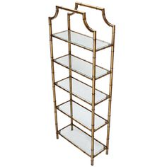 Mid Century Modern 5 Tier Faux Bamboo Etagere Shelving Unit   From a unique collection of antique and modern shelves at https://www.1stdibs.com/furniture/storage-case-pieces/shelves/