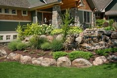HGTV presents a front yard space featuring a rock garden with stream, waterfall…