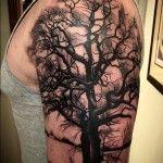 Dark Tree On Guys Arm | Tattoo Ideas