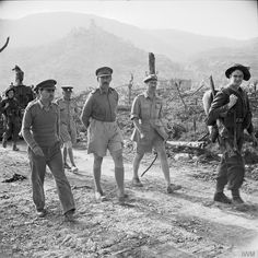 The Commander of the 8th Army, General Sir Oliver Leese walking through Cassino after its capture.