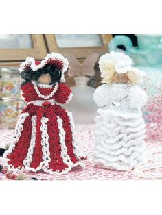 "Elegant finery adorns these clothespin dolls sure to be a treasured addition to any collection. Size: 4 1/2"" tall."