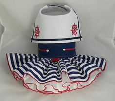 I don't think i could ever dress Daisy but this is wicked cute. Small dog harness dress.Sailor by poshdog on Etsy, $65.00
