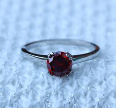 Genuine Garnet 1ct solitaire ring in Titanium or White Gold - engagement ring - wedding ring - handmade ring by TheAladdinsCave on Etsy https://www.etsy.com/listing/205305150/genuine-garnet-1ct-solitaire-ring-in