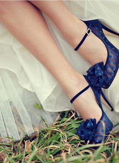 """Many brides are opting to tie in their """"something blue"""" by opting a pop of color on their feet! I think it's such a great idea to have a pop of color for your shoes, even if it's not blue! These super girly polka-dotted shoes are so chic!"""