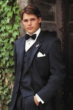 Navy tux - change the bowtie to a full length white tie, and make the vest white for an inverse look of the groom