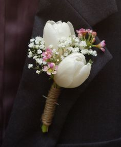White tulip, wax flower, and baby's breath mother of the bride corsage with twine / http://www.himisspuff.com/white-tulip-wedding-ideas-for-spring-weddings/3/