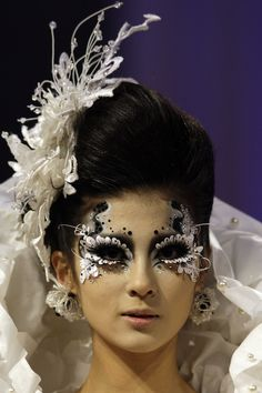 [Beijing, October 25: A model takes part in the Eonfashion award, a make-up styling contest held as part of China Fashion week. Image via AP.]