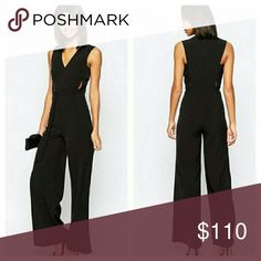 ASOS Black D-Ring Jumpsuit NWTs. UK size 6 / US size 2. Poly/elastane blend. Flared legs. Zip closure. Attached belt detail at front. ASOS Pants Jumpsuits & Rompers