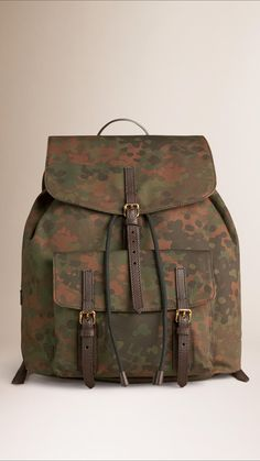 56ea2eb66e8 Burberry   Camouflage print canvas backpack with a textured leather trim  Foldover top. Man Shop