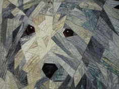 "close up,  ""Snow Buddies"" (this is a Komondor)  by Ruth Powers, who says:  ""my work is entirely pieced by machine from bits of commercially printed or hand dyed fabrics and then machine quilted."""