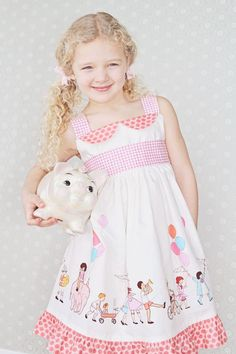 Adorable dress using Sarah Jane's Children at play on parade print fabric
