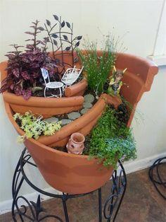 Craft ideas: Turning A Broken Flowers Pot Into An Art In Your Garden.